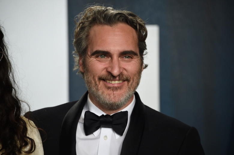 Joaquin Phoenix arrives at the Vanity Fair Oscar Party on Sunday, Feb. 9, 2020, in Beverly Hills, Calif. (Photo by Evan Agostini/Invision/AP)