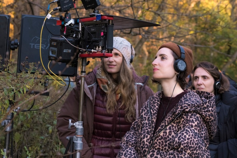 (l-r) Executive producer Natalia Anderson  director/writer Zoe Lister-Jones  and executive producer Bea Sequeira observe the monitors on set of Columbia Pictures' THE CRAFT: LEGACY.