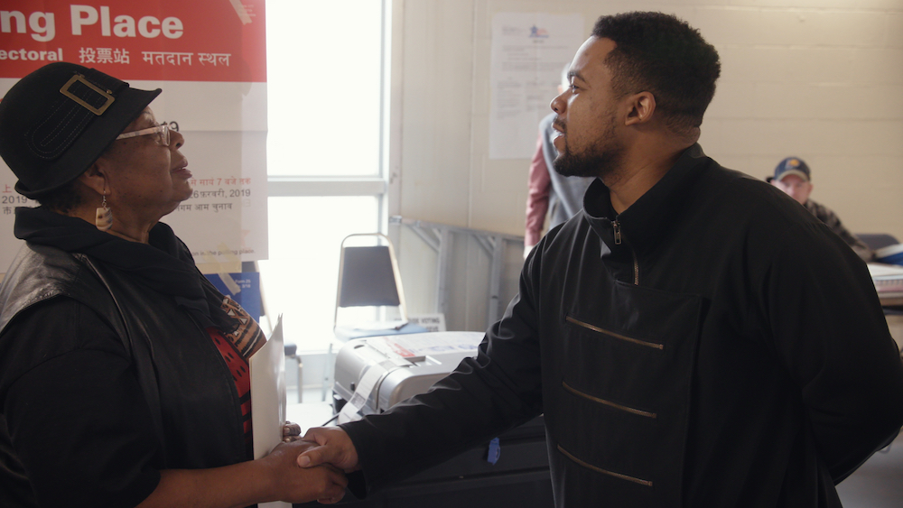 Neal Sales-Griffin shakes a judges hand at a voting site. (Chicago Story Film, LLC)