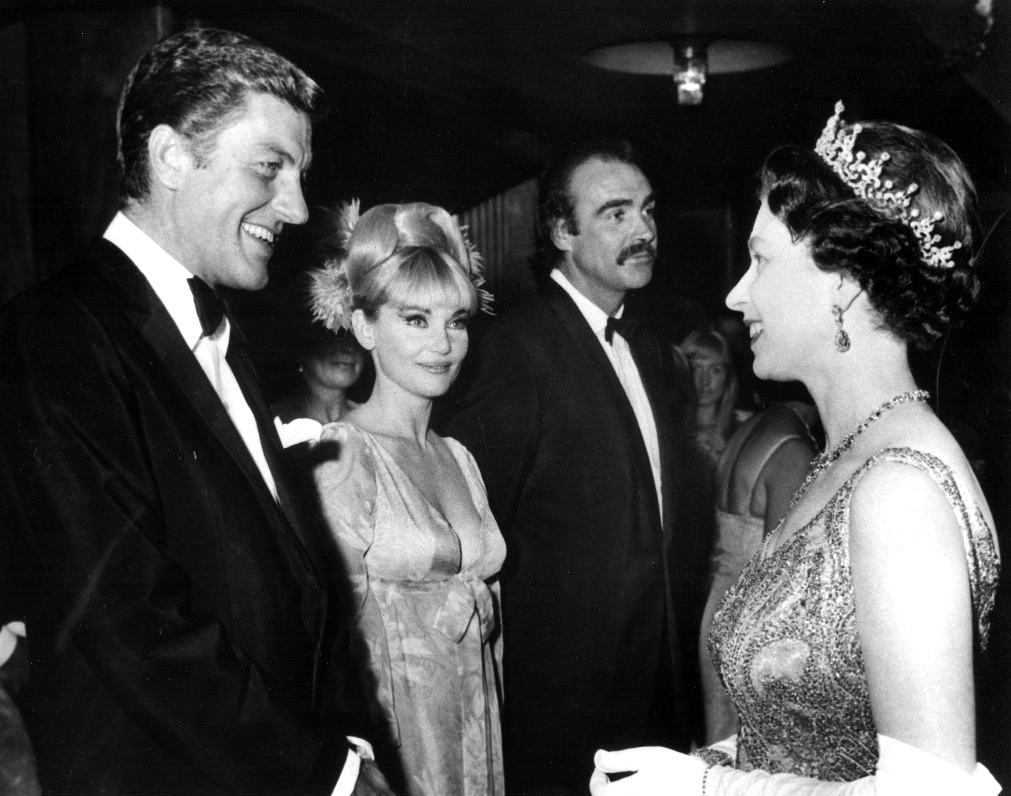 Queen Elizabeth II meeting Dick Van Dyke, Diane Cilento, and Sean Connery at the London premiere of 'You Only Live Twice' ca. 1967