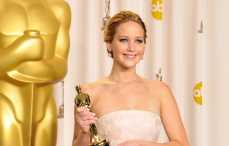 Jennifer Lawrence with her Best Actress award at the 2013 Oscars