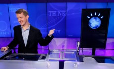"""Jeopardy!"" contest Ken Jennings, who won a record 74 consecutive games, refers to his opponent, an IBM computer called ""Watson"", while being interviewed after a practice round of the ""Jeopardy!"" quiz show in Yorktown Heights, N.Y., Thursday, Jan. 13, 2011. It's the size of 10 refrigerators, and it swallows encyclopedias whole, but an IBM computer was lacking one thing it needed to battle the greatest champions from the ""Jeopardy!"" quiz TV show - it couldn't hit a buzzer. But that's been fixed, and on Thursday the hardware and software system named Watson played a competitive practice round against two champions. A ""Jeopardy!"" show featuring the computer will air in mid-February, 2011. (AP Photo/Seth Wenig)"