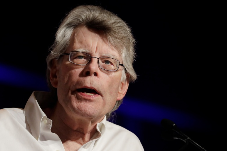 """FILE - In this June 1, 2017 file photo, author Stephen King speaks at Book Expo America, Thursday, June 1, 2017, in New York.  King is retaliating against President Donald Trump for blocking him on Twitter. In a post late Thursday, Aug. 24, the Maine horror author said he would block Trump from seeing the upcoming movie """"It"""" or the currently showing television series """"Mr. Mercedes,"""" both based on his books. King's tweet says """"No clowns for you, Donald. Go float yourself."""" (AP Photo/Mark Lennihan)"""