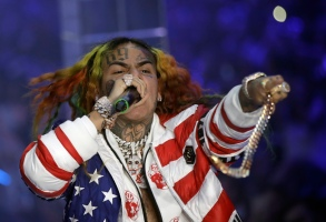 Rapper Daniel Hernandez, known as Tekashi, performs during the Philipp Plein women's 2019 Spring-Summer collection, unveiled during the Fashion Week in Milan, Italy, Friday, Sept. 21, 2018. (AP Photo/Luca Bruno)