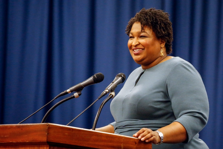 CORRECTS SPELLING OF FIRST NAME TO STACEY INSTEAD OF STACY - Stacey Abrams speaks at the unity breakfast, Sunday, March 1, 2020, in Selma, Ala. (AP Photo/Butch Dill)
