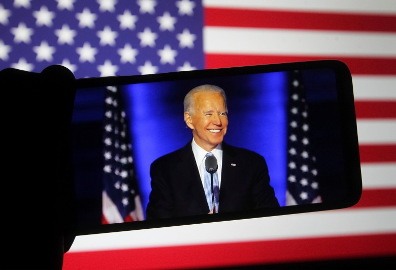 In this photo illustration the US Democratic presidential candidate Joe Biden speaks during a rally in Wilmington on a YouTube video displayed on a screen of a smartphone. (Photo by Pavlo Gonchar / SOPA Images/Sipa USA)(Sipa via AP Images)