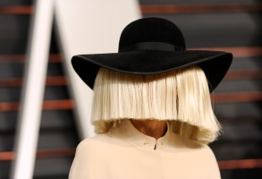 Sia arrives at the 2015 Vanity Fair Oscar Party on Sunday, Feb. 22, 2015, in Beverly Hills, Calif. (Photo by Evan Agostini/Invision/AP)