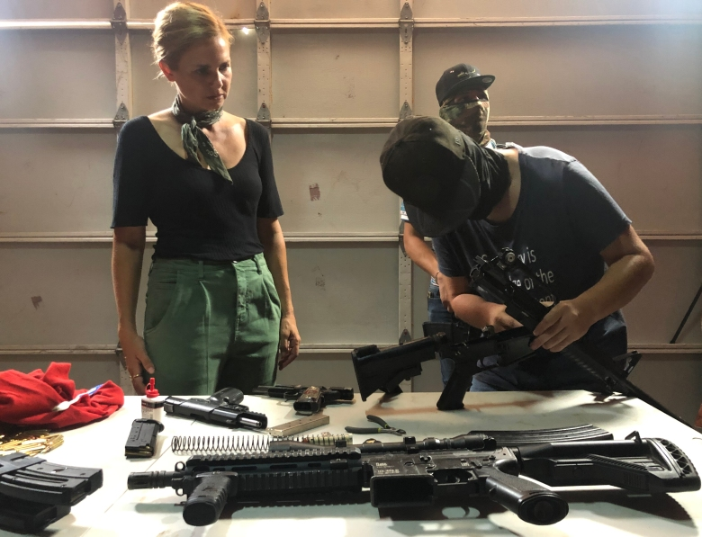 Sinaloa, Mexico - Mariana van Zeller (L) observes Sinaloa Cartel gunsmiths as they work on their arsenal. (Credit: National Geographic/Muck Media)