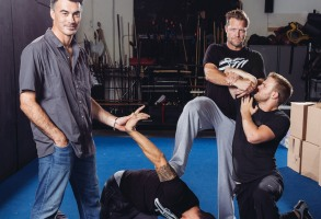 """Chad Stahelski, left, and David Leitch, second right, co-directors of the film, """"John Wick,"""" demonstrate holding techniques during a training session at 87Eleven Action Design in Inglewood, Calif. Stahelski and Leitch have a shorthand when it comes to shooting sprees, mixed martial arts throw-downs, crazy car crashes and all kinds of explosions. After two decades performing, choreographing, coordinating and directing movie stunts together, Stahelski and Leitch have become experts at big-screen thrills. Their new movie starring Keanu Reeeves releases in theaters on Oct. 24""""John Wick"""" Portrait Session, Inglewood, USA - 7 Oct 2014"""