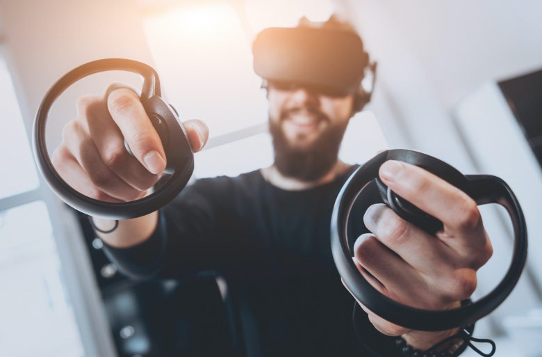 The young man plays a game at the office. Virtual reality