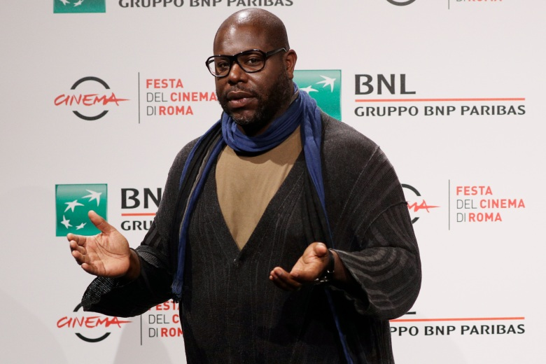 """Director Steve McQueen poses during a photo call for the movie """"Small Axe"""", at the Rome Film Fest, in Rome, Friday, Oct. 16, 2020. (AP Photo/Gregorio Borgia)"""