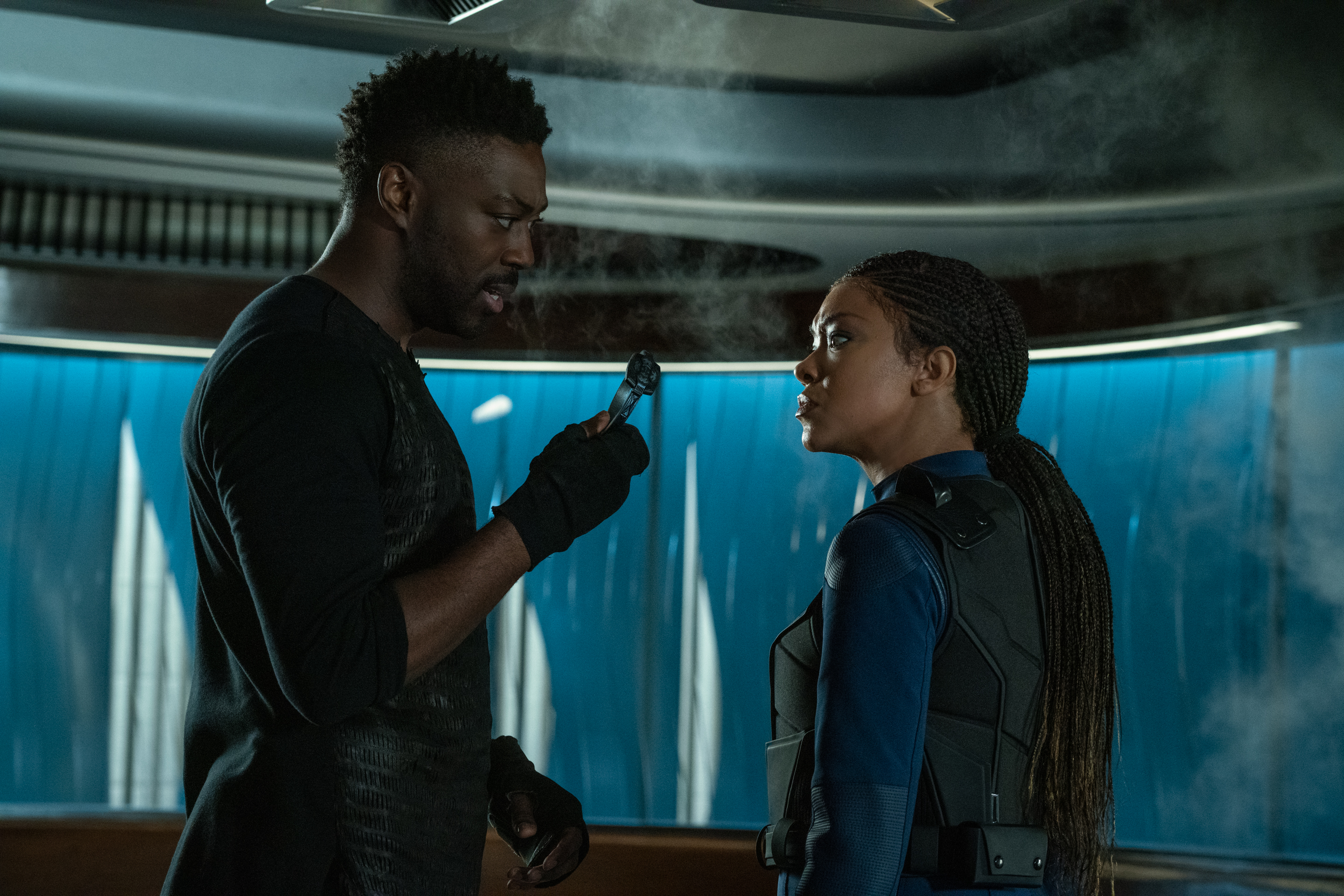"""""""There Is A Tide..."""" — Ep#312 — Pictured (L-R): David Ajala as Book and Sonequa Martin-Green as Commander Burnham of the CBS All Access series STAR TREK: DISCOVERY. Photo Cr: Michael Gibson/CBS ©2020 CBS Interactive, Inc. All Rights Reserved."""