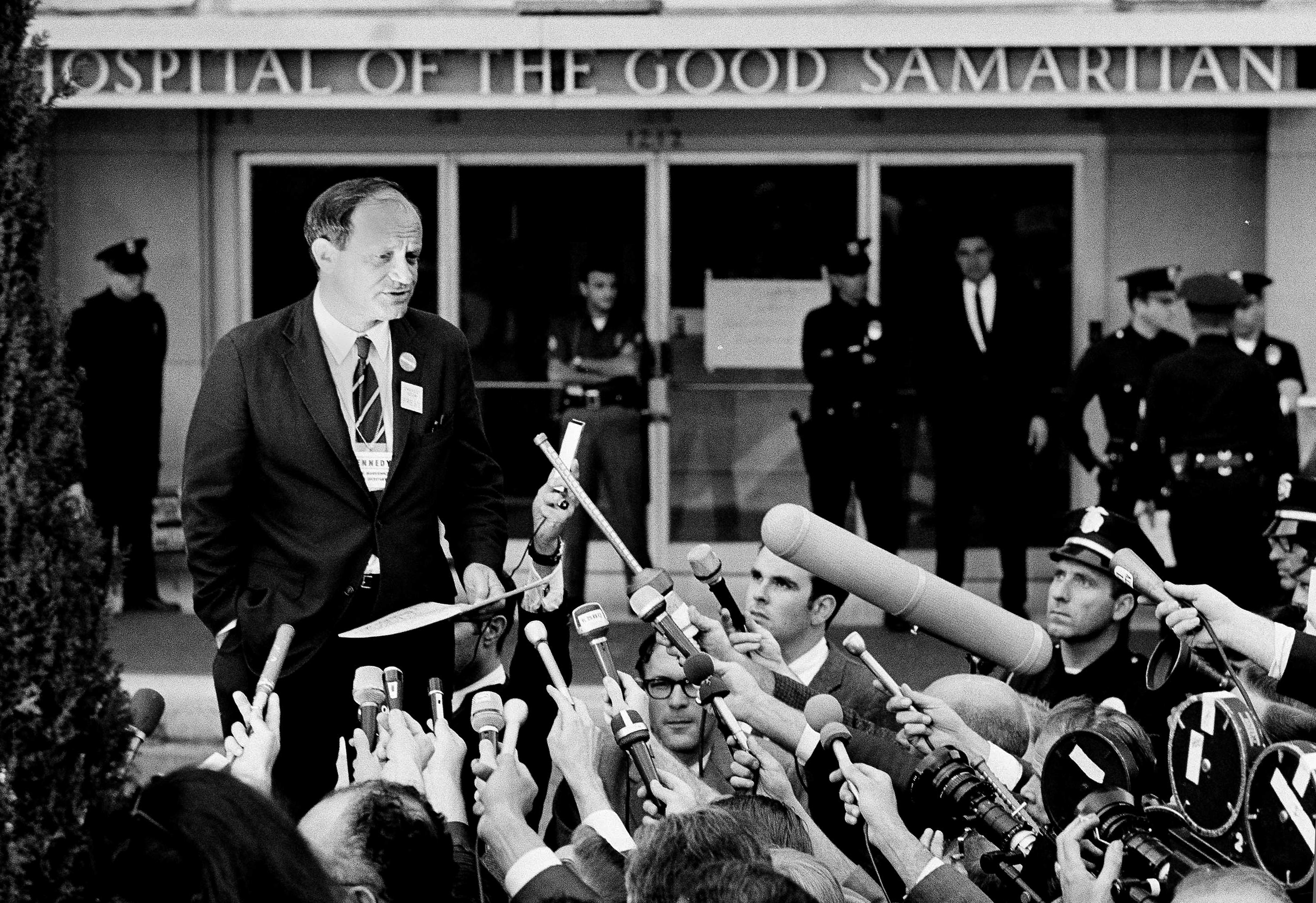 """FILE - In this June 5, 1968 file photo, Frank Mankiewicz, Sen. Robert F. Kennedy's press secretary, tells a news conference outside Good Samaritan hospital in Los Angeles that Kennedy emerged from three hours of surgery in """"extremely critical condition."""" Kennedy died later that day. Associated Press Hollywood reporter Bob Thomas was on a one-night political assignment covering Kennedy's victory celebration in the California presidential primary at the Ambassador Hotel when mayhem unfolded before his eyes. (AP Photo, File)"""