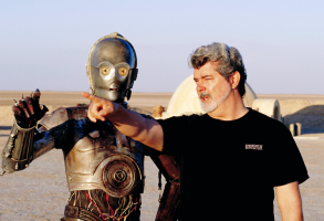 "Anthony Daniels as C-3PO and George Lucas, on set of ""Star Wars: Attack of the Clones"""