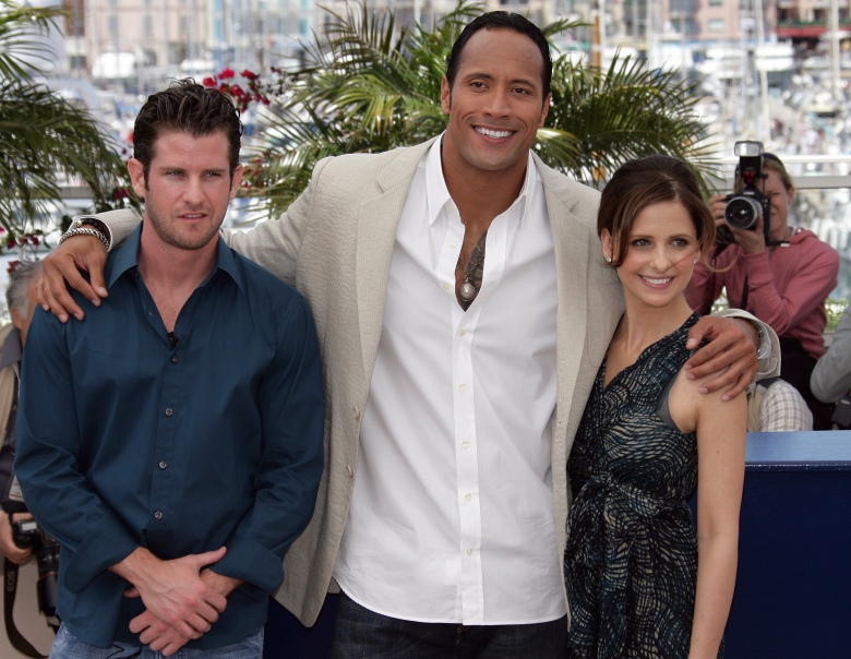 "American director Richard Kelly, left, American actor Dwayne ""The Rock"" Johnson, center, and American actress Sarah Michelle Gellar pose during a photo call for their film ""Southland Tales,"" at the 59th International film festival in Cannes, southern France, on Sunday, May 21, 2006.  (AP Photo/Francois Mori)"
