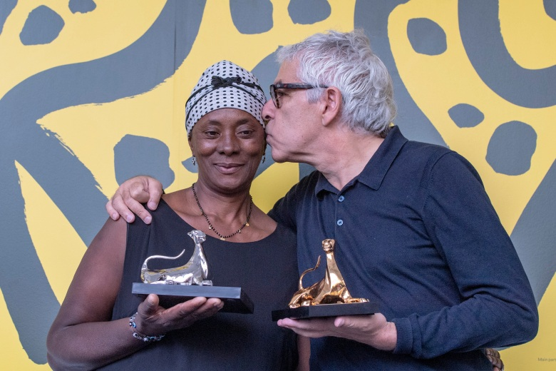 "Film Director Pedro Costa, right, from Portugal poses with the ''Pardo d'oro'' trophy for the best Film with actress Vitalina Varela, left, from Cabo Verde for the ""best actress"" from the Film ""Vitalina Varela "" during the photocall at the 72th Locarno International Film Festival in Locarno, Switzerland, Saturday, Aug, 17, 2019. The Festival del film Locarno runs from 7 to 17 August 2019. (Urs Flueeler/Keystone via AP)"