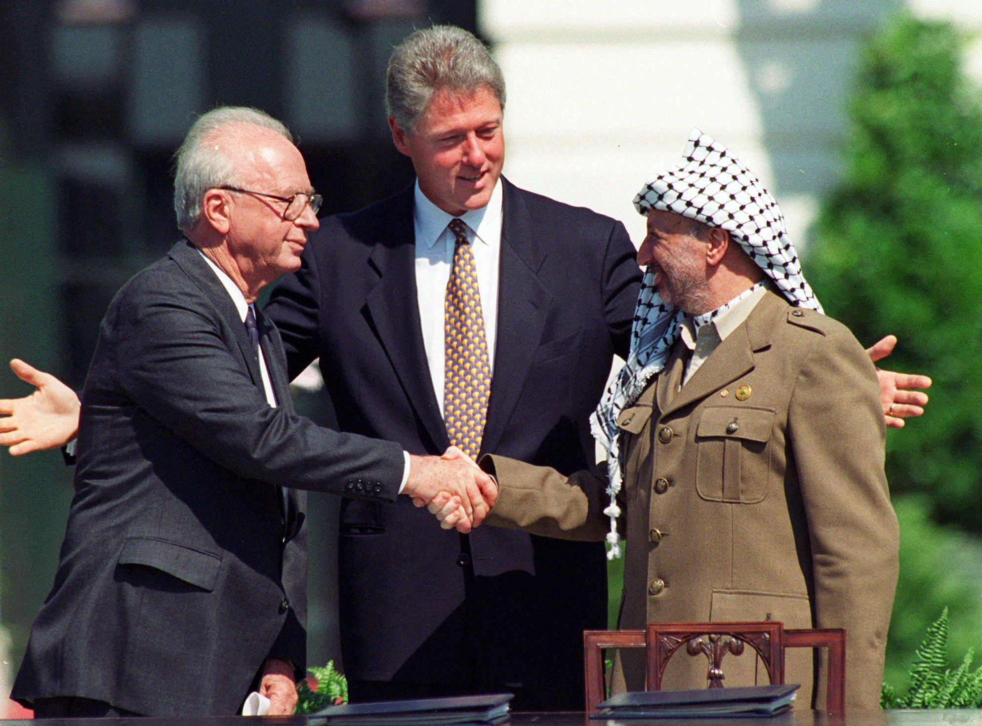 FILE - In this Sept. 13, 1993 file photo President Clinton presides over White House ceremonies marking the signing of the peace accord between Israel and the Palestinians with Israeli Prime Minister Yitzhak Rabin, left, and Palestinian leader Yasser Arafat, right, in Washington. Two years after the groundbreaking handshake on the White House lawn between the two men, Rabin was killed by an Israeli extremist opposed to peace negotiations with the Palestinians at a rally promoting the accords. (AP Photo/Ron Edmonds, File)