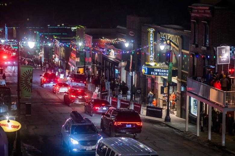 Cars drive down Main Street during