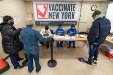 Screeners register residents of the William Reid Apartments at a COVID-19 pop-up vaccination site at the NYCHA housing complex, Saturday, Jan. 23, 2021 in the Brooklyn borough of New York. (AP Photo/Mary Altaffer, Pool)