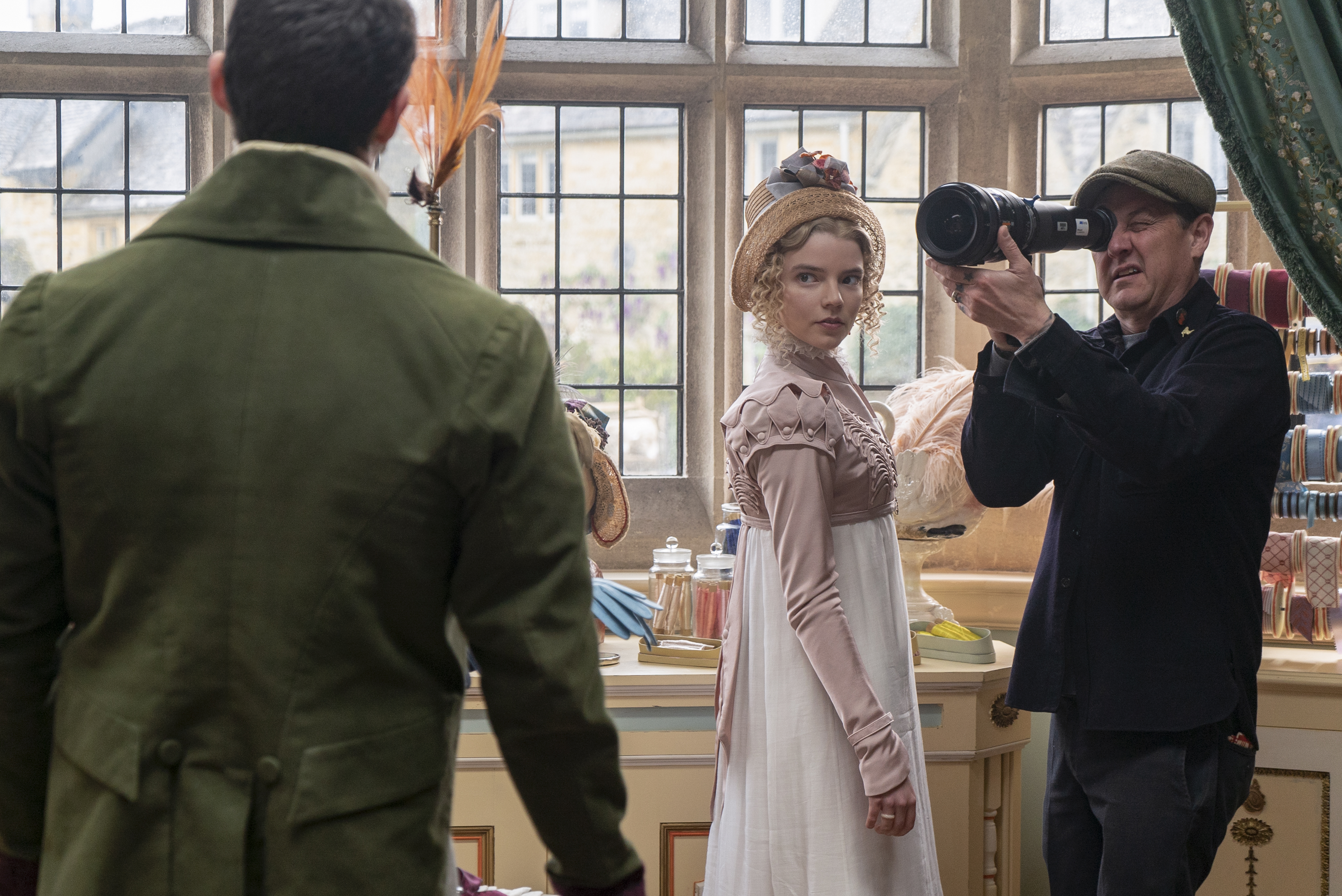 (L to R) Actor Callum Turner, actor Anya Taylor-Joy and director of photography Christopher Blauvelt on the set of EMMA., a Focus Features release. Credit : Liam Daniel / Focus Features