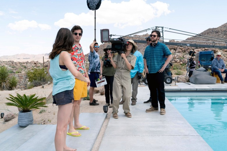 PALM SPRINGS, first two from left: Cristin Milioti, Andy Samberg; in blue shirt at center: director Max Barbakow, on set, 2020. ph: Jessica Perez / © Hulu / Courtesy Everett Collection