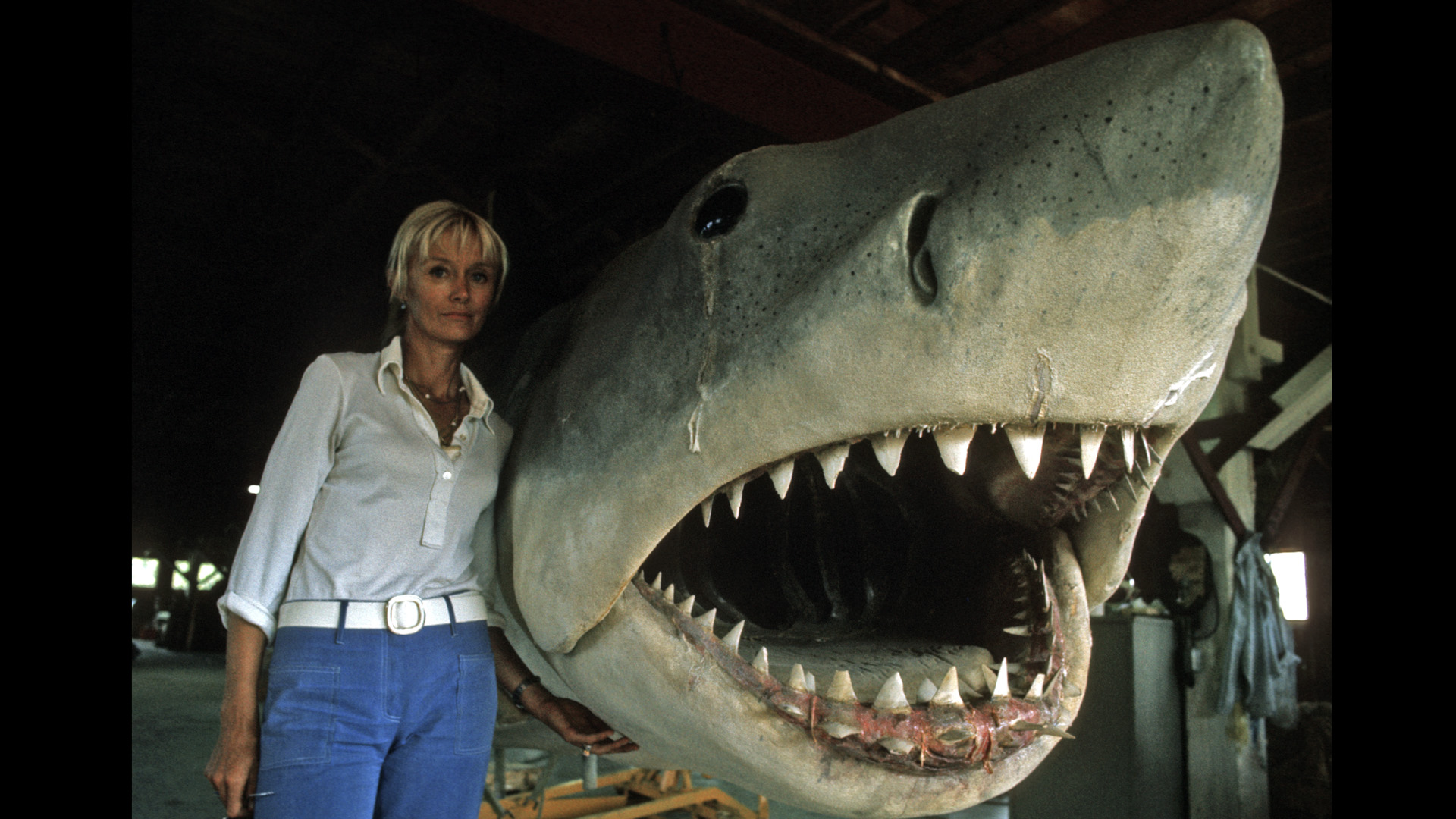 """Valerie Taylor in the work shop on Marthas Vinyard with """"Bruce"""" the mechanical Great White shark, during the filming of JAWS."""