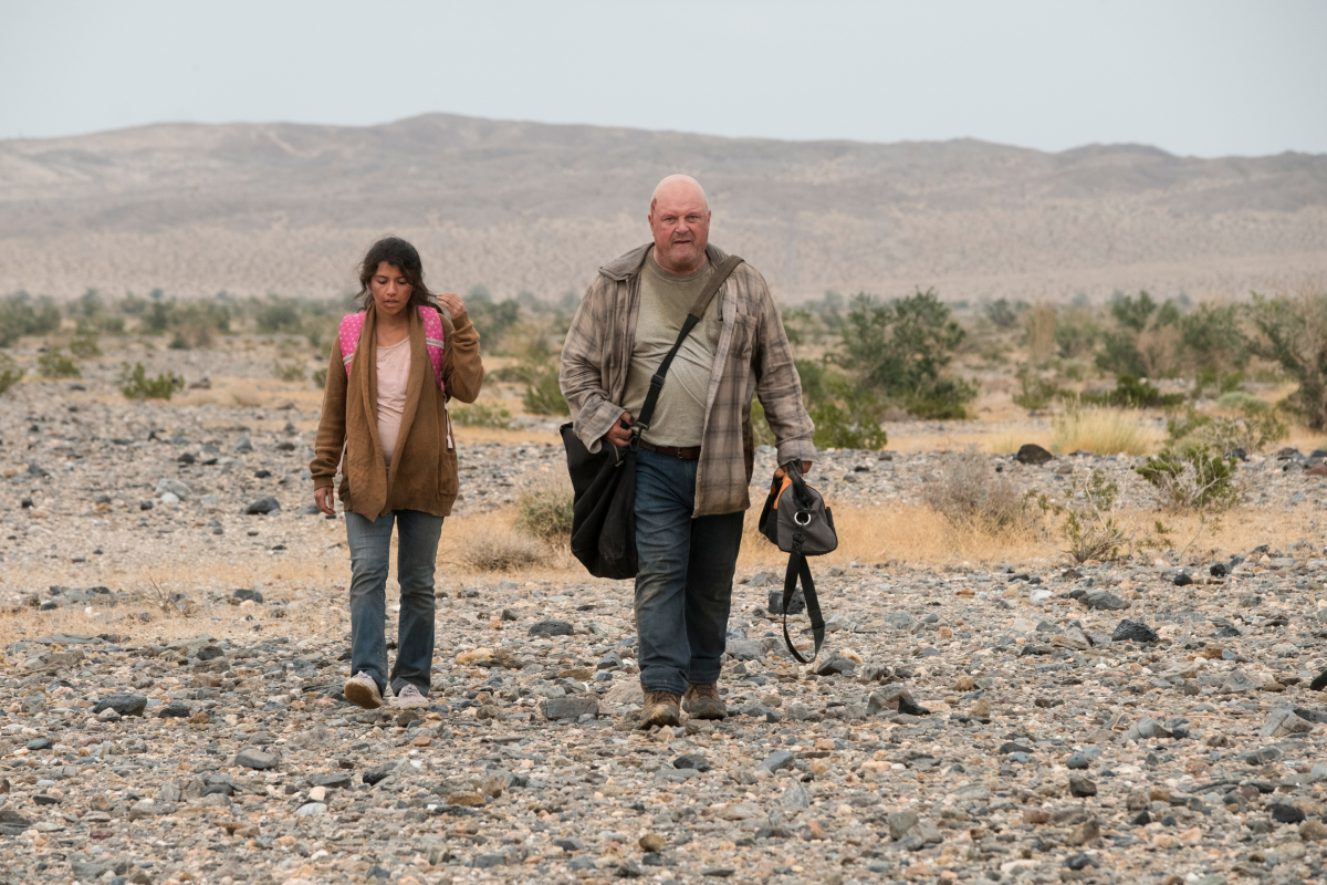 "Coyote -- Episode 102: ""Silver or Lead"" — Pictured (L-R): Emy Mena as Maria Elena and Michael Chiklis as Ben Clemens of the CBS All Access exclusive series COYOTE. Photo Credit: Cate Cameron/Viacom CBS ©2020 CBS Interactive, Inc. All Rights Reserved"