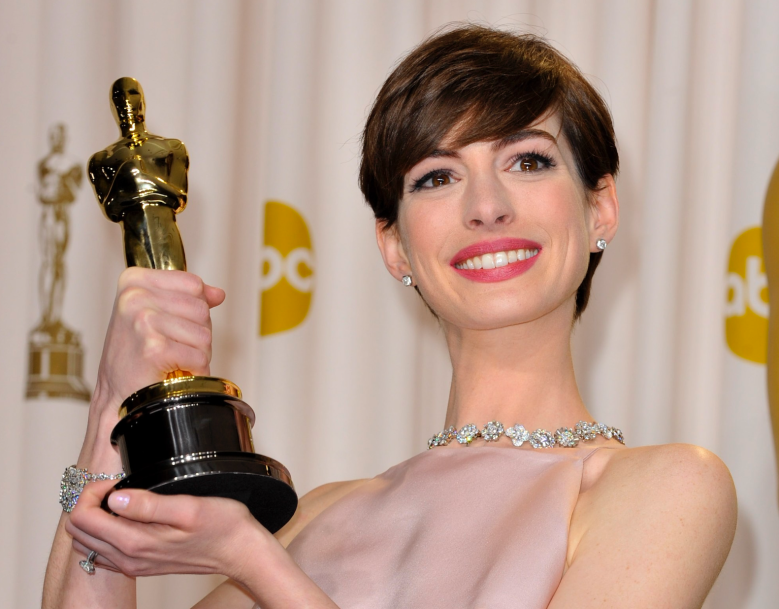 Anne Hathaway with her Oscar