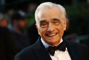 """FILE - In this Sunday, Oct. 13, 2019, file photo, director Martin Scorsese poses for photographers upon arrival at the premiere of the film """"The Irishman"""" as part of the London Film Festival, in central London. Scorsese and his mob epic """"The Irishman"""" have been honored by the AARP. In a Saturday night, Jan. 11, 2020, ceremony, the group named it the top movie for grownups in the past year, defining that group as people aged 50 and over. (Photo by Joel C Ryan/Invision/AP, File)"""