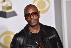 """FILE - In this Jan. 28, 2018 file photo, Dave Chappelle poses in the press room with the best comedy album award for """"The Age of Spin"""" and """"Deep in the Heart of Texas"""" at the 60th annual Grammy Awards in New York. Chappelle celebrated George Floyd's life and ripped the media for the way it handled his death in a surprise Netflix special. The special was released Thursday and is streaming free on Netflix's comedy YouTube channel.  (Photo by Charles Sykes/Invision/AP, File)"""