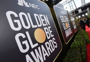 FILE - Event signage appears above the red carpet at the 77th annual Golden Globe Awards, Sunday, Jan. 5, 2020, in Beverly Hills, Calif. Nominations for the 78th annual Golden Globes will be announced on Wednesday, Feb. 2, 2021. (Photo by Jordan Strauss/Invision/AP, File)