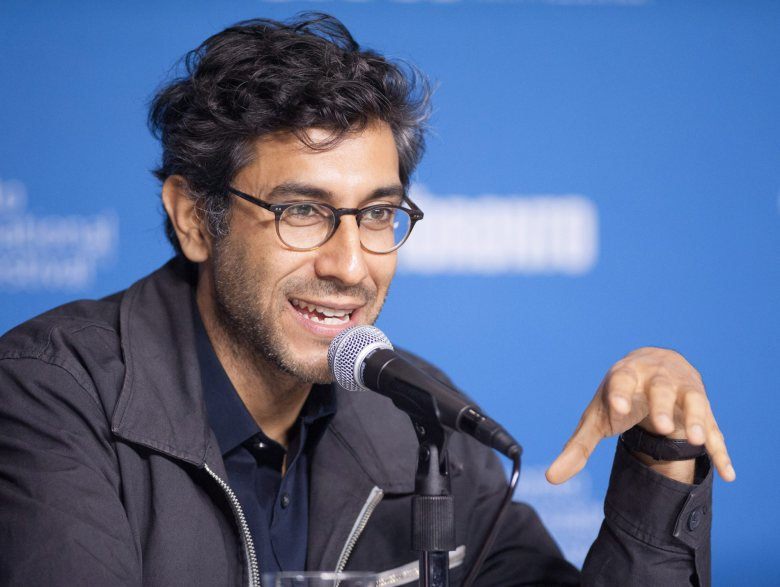 """Director Ramin Bahrani speaks during a press conference for """"99 Homes"""" at the 2014 Toronto International Film Festival in Toronto on Tuesday, Sept. 9, 2014. (AP Photo/The Canadian Press, Hannah Yoon)"""