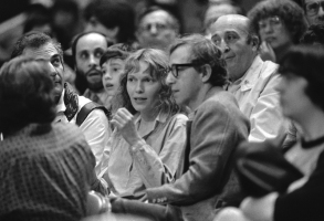 Actress Mia Farrow and Woody Allen watch the Philadelphia 76ers and the New York Knicks battle on the court at Madison Square Garden in New York  Saturday, April 30, 1983. (AP Photo/Bill Kostroun)