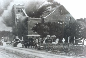 Mt. Zion Baptist Church burns after being torched by white mobs during the 1921 Tulsa race riot. On Monday, Aug. 9, 1999, the Tulsa Race Riot Commission will meet in its continuing investigation to determine exactly what happened during the two days of rioting and whether reparations should be paid to survivors. (AP Photo/Greenwood Cultural Center via Tulsa World)