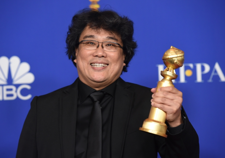 """Director Bong Joon-ho poses in the press room with the award for best foreign language motion picture for """"Parasite"""" at the 77th annual Golden Globe Awards at the Beverly Hilton Hotel on Sunday, Jan. 5, 2020, in Beverly Hills, Calif. (AP Photo/Chris Pizzello)"""