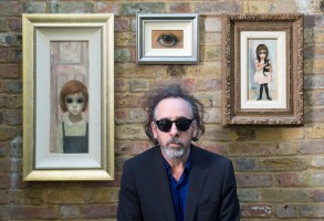 BIG EYES, director Tim Burton with his vintage Margaret Keane paintings, October 28, 2014. ph: Leah Gallo/©Weinstein Company/Courtesy Everett Collection