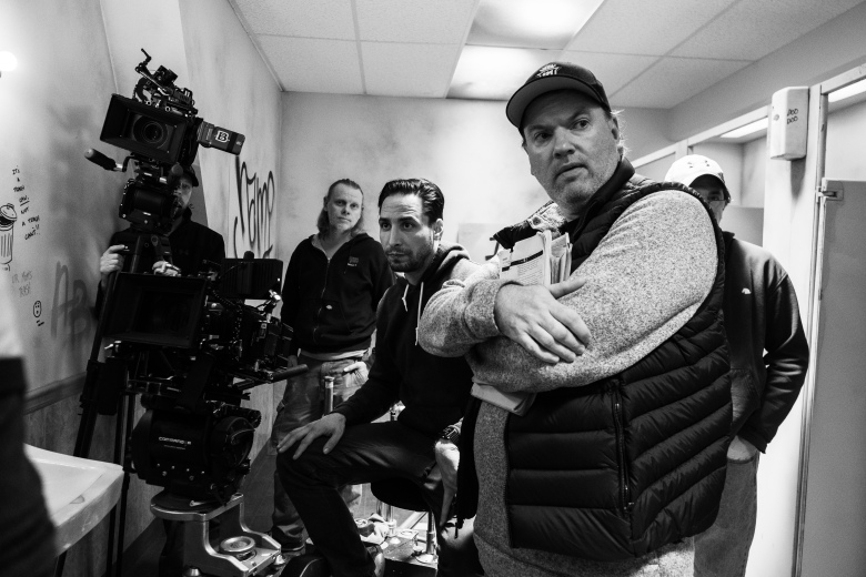 """Front to back: director Kevin Lewis, cinematographer Dave Newbert, and dolly grip Jeremy Wren on the set of """"Willy's Wonderland."""""""