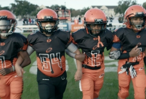 "9U team during game in episode 4 ""Any Darn Day"" of We Are: The Brooklyn Saints S1. Cr. NETFLIX © 2021"
