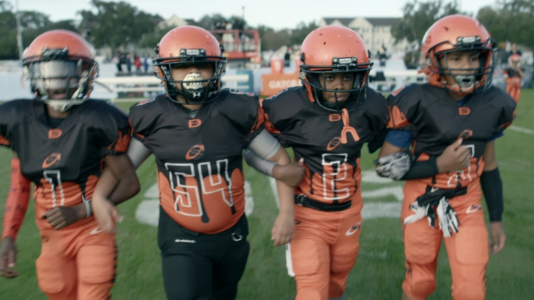 """9U team during game in episode 4 """"Any Darn Day"""" of We Are: The Brooklyn Saints S1. Cr. NETFLIX © 2021"""