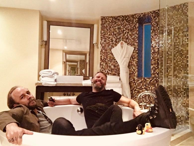 Derek Cianfrance and Darius Marder in a bathtub