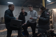 """(from left) Bob Odenkirk, producer David Leitch, director Ilya Naishuller and producer Kelly McCormick on the set of """"Nobody."""""""
