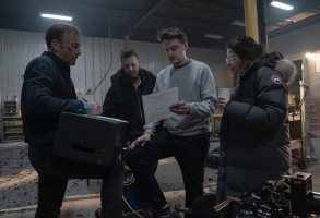 "(from left) Bob Odenkirk, producer David Leitch, director Ilya Naishuller and producer Kelly McCormick on the set of ""Nobody."""