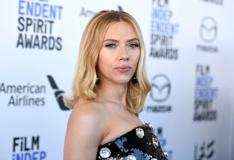 FILE - In this Feb. 8, 2020, file photo, Scarlett Johansson arrives at the 35th Film Independent Spirit Awards in Santa Monica, Calif. The Johansson Marvel release, whose May 1 opening would have marked the de facto start of the summer movie season, has been postponed indefinitely by the Walt Disney Co. (Photo by Richard Shotwell/Invision/AP, file)