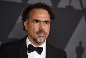 "FILE - Alejandro Gonzalez Inarritu arrives at the 9th annual Governors Awards in Los Angeles on Nov. 11, 2017. Inarritu inaugurated the Morelia Film Festival 2020 on oct. 28, 2020 with a restored copy of his ""Amores Perros."" (Photo by Jordan Strauss/Invision/AP, File)"