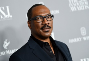 """FILE - Honoree actor-comedian Eddie Murphy attends the WSJ. Magazine 2019 Innovator Awards in New York on Nov. 6, 2019. """"Coming 2 America,"""" the sequel to the 1988 Eddie Murphy comedy, has landed on a date to come to audiences. Amazon Studios announced Friday that the film which reunites Murphy and Arsenio Hall will debut on Amazon Prime Video on March 5, 2021.  (Photo by Evan Agostini/Invision/AP, File)"""
