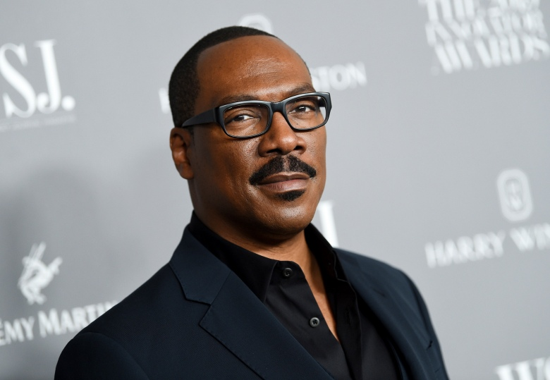 "FILE - Honoree actor-comedian Eddie Murphy attends the WSJ. Magazine 2019 Innovator Awards in New York on Nov. 6, 2019. ""Coming 2 America,"" the sequel to the 1988 Eddie Murphy comedy, has landed on a date to come to audiences. Amazon Studios announced Friday that the film which reunites Murphy and Arsenio Hall will debut on Amazon Prime Video on March 5, 2021.  (Photo by Evan Agostini/Invision/AP, File)"