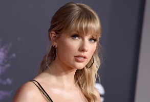 """FILE - This Nov. 24, 2019 file photo shows Taylor Swift at the American Music Awards in Los Angeles. Swift announced online that she's dropping the first of her re-recorded albums. She said """"Fearless: Taylor's Version"""" features re-recorded songs from her sophomore album, """"Fearless."""" The new set will also contain six never-before released songs. Swift will also release a new version of her song """"Love Story"""" from """"Fearless"""" on Thursday at midnight. (Photo by Jordan Strauss/Invision/AP, File)"""