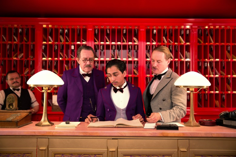 THE GRAND BUDAPEST HOTEL, from left: Tom Wilkinson, Tony Revolori, Owen Wilson, 2014. ph: Martin Scali/TM and Copyright ©Fox Searchlight Pictures/courtesy Everett Collection