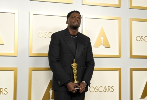 """Daniel Kaluuya, winner of the award for best actor in a supporting role for """"Judas and the Black Messiah,"""" poses in the press room at the Oscars on Sunday, April 25, 2021, at Union Station in Los Angeles. (AP Photo/Chris Pizzello, Pool)"""