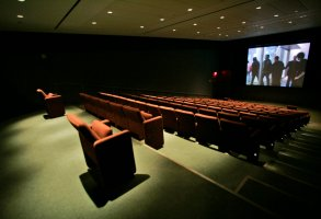 A movie is screened in the empty Celeste Bartos theater during the press preview of the Lewis B. and Dorothy Cullman Education and Research building at the Museum of Modern Art Tuesday, Nov. 21, 2006 in New York. The building opens Nov. 28, marking the completion of the MOMA's expansion and renovation project. (AP Photo/Mary Altaffer)